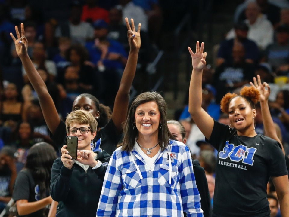 <strong>Lady Tigers head coach Melissa McFerrin (middle) celebrates with her team during Memphis Madness at FedExForum Thursday, Oct. 3.</strong> (Mark Weber/Daily Memphian)