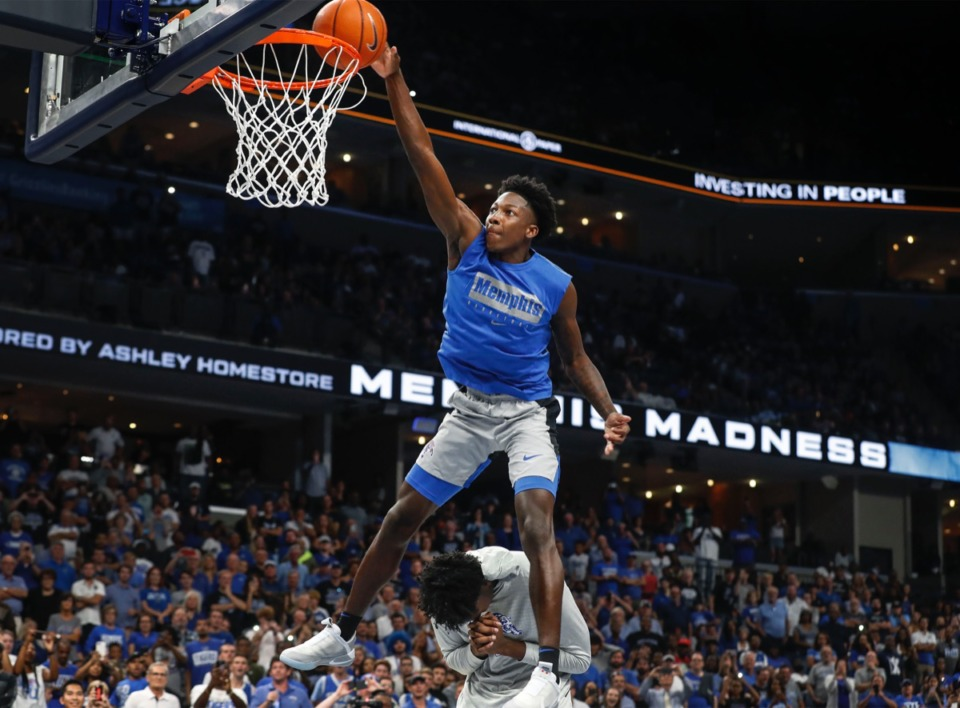 <strong>Tiger Damion Baugh (top) jumps over teammate James Wiseman while completing a dunk during Memphis Madness at FedExForum Thursday, Oct. 3.</strong> (Mark Weber/Daily Memphian)