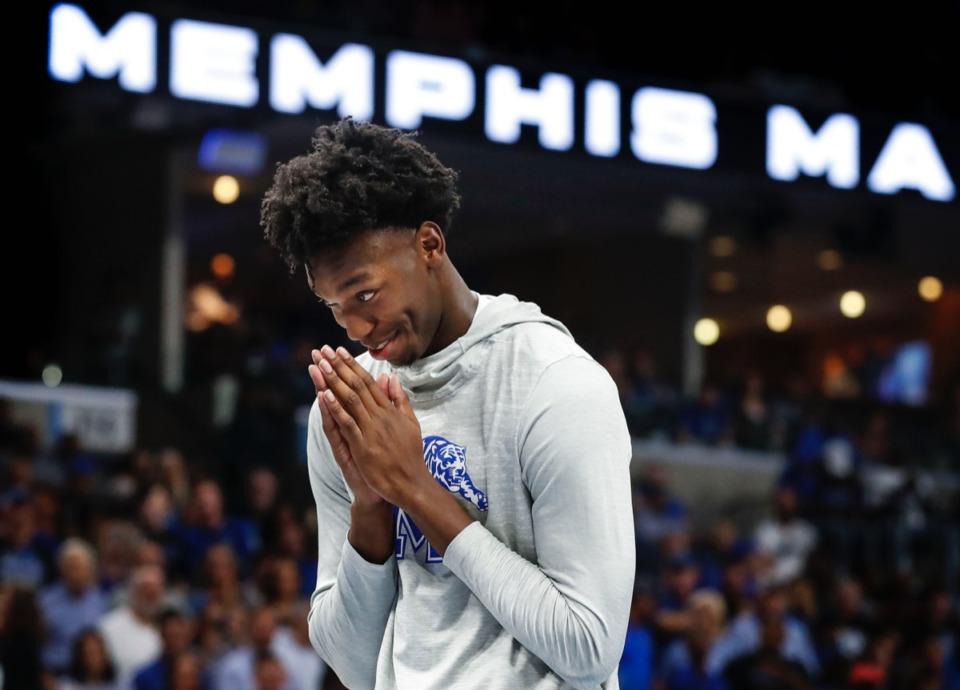<strong>Tiger James Wiseman mimes a prayer as teammate Damion Baugh jumps over him Oct. 3.</strong> (Mark Weber/Daily Memphian)