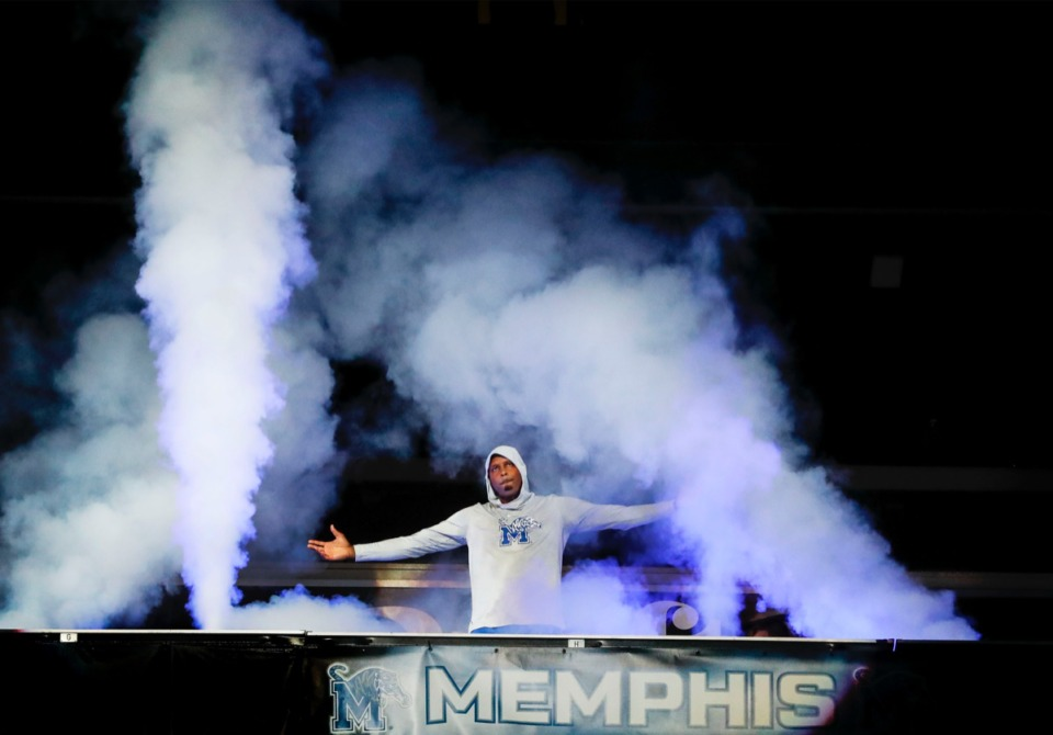<strong>Tigers head coach Penny Hardaway emerges dramatically from smoke at FedExForum Thursday, Oct. 3.</strong> (Mark Weber/Daily Memphian)