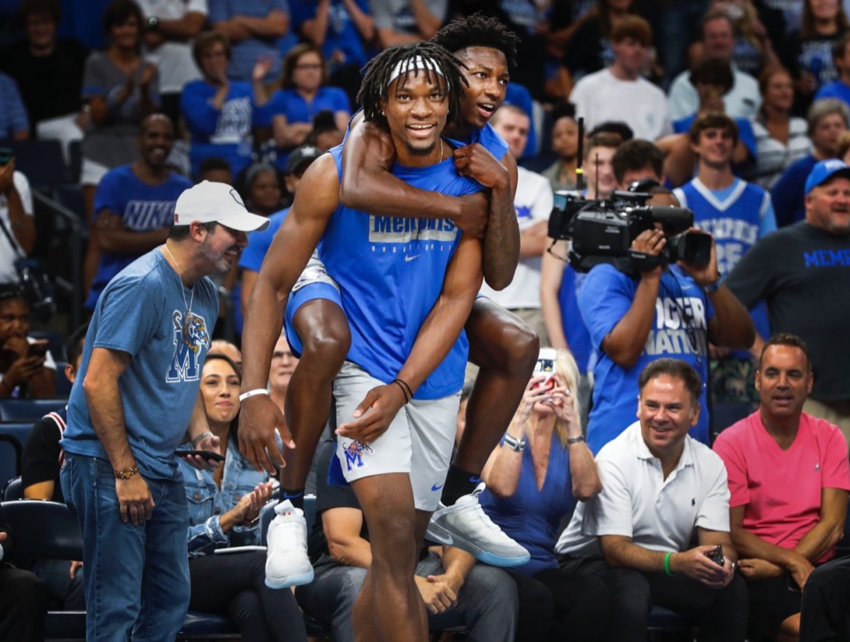 <strong>Tigers Precious Achiuwa (front) and Damion Baugh (back) celebrate during Memphis Madness.</strong> (Mark Weber/Daily Memphian)