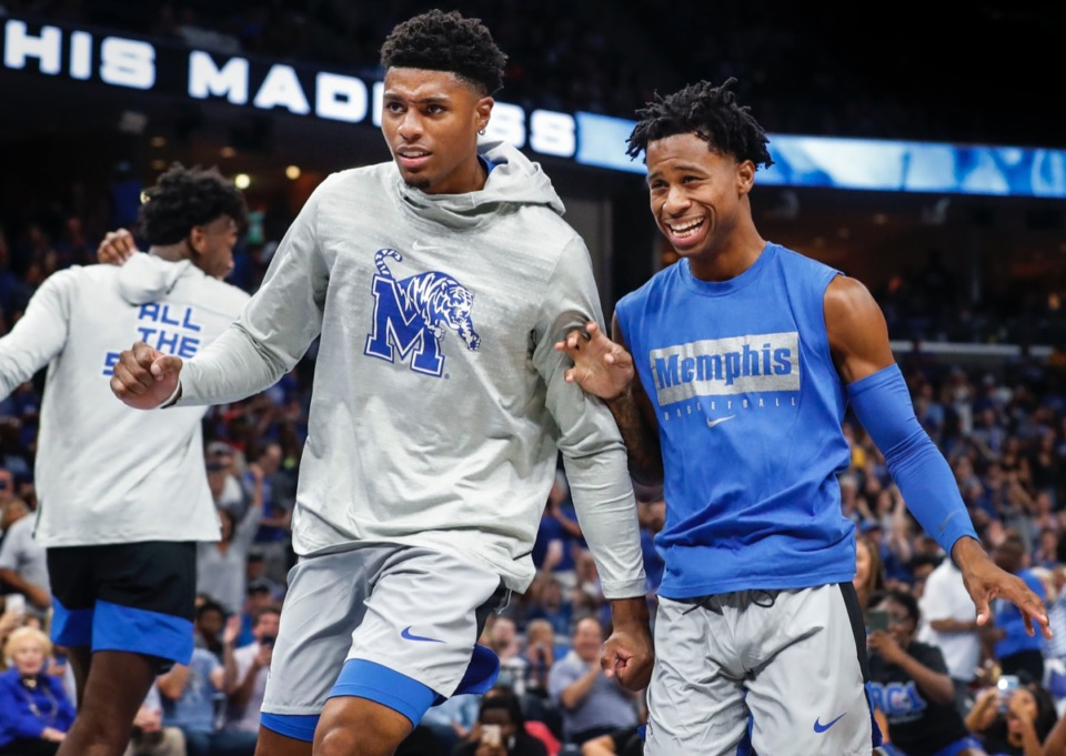 <strong>Tiger teammates Ryan Boyce (left) and Tyler Harris (right) celebrate during Memphis Madness.</strong> (Mark Weber/Daily Memphian)