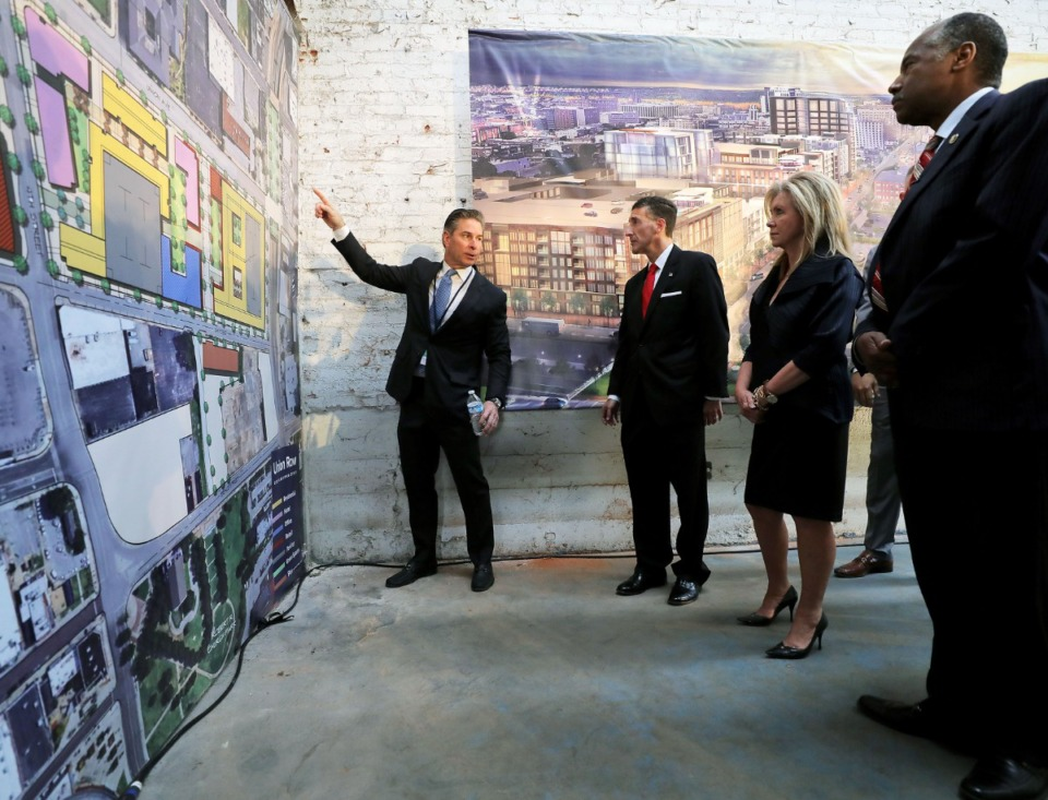 <strong>Developer Kevin Adams (left) shows Secretary of Housing and Urban Development Ben Carson (from right), Sen. Marsha Blackburn and Rep. David Kustoff his Union Row plans while Carson was in Memphis on Oct. 4, 2019.</strong> (Patrick Lantrip/Daily Memphian)