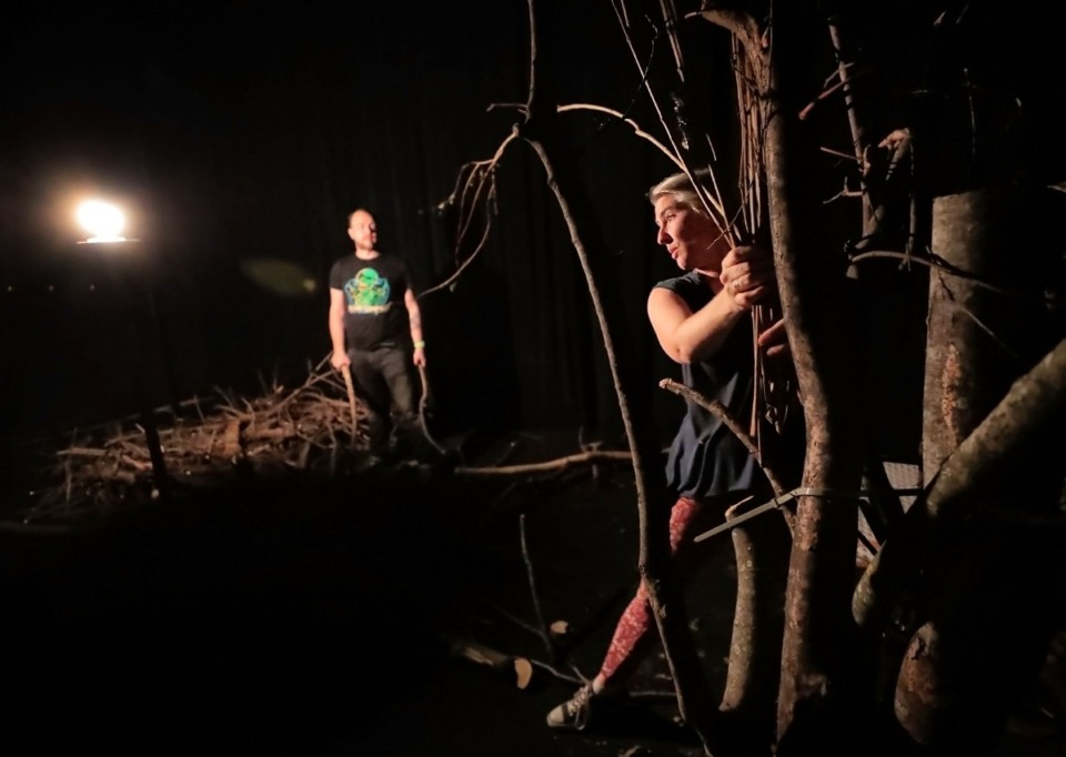 """<strong>Julia Hinson (right) and David Galloway work together on set design on Sept. 27, 2019, for the upcoming production of """"The Parting,"""" an immersive&nbsp;<span>story-oriented paranormal experience&nbsp;</span>at the Evergreen Theater.</strong> (Jim Weber/Daily Memphian)"""