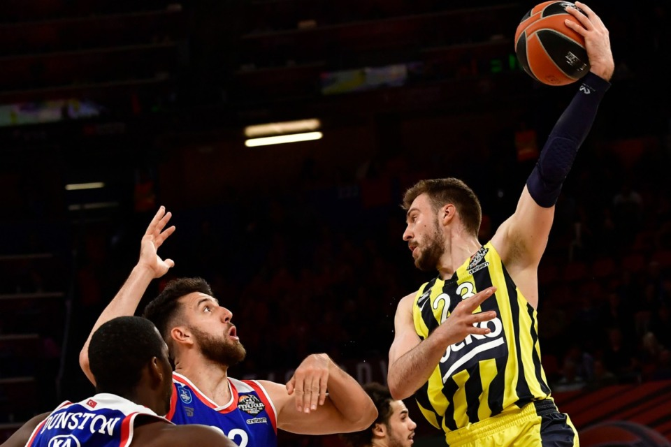 <strong>The Memphis Grizzlies signed Marko Guduric, right, to a two-year $5.3 million contract. The shooting guard (shown on May 17, 2019, during the Euroleague Final Four semifinal basketball match between Anadolu Efes Istanbul and Fenerbahce) played four seasons in EuroLeague.</strong> (Alvaro Barrientos/Associated Press file)