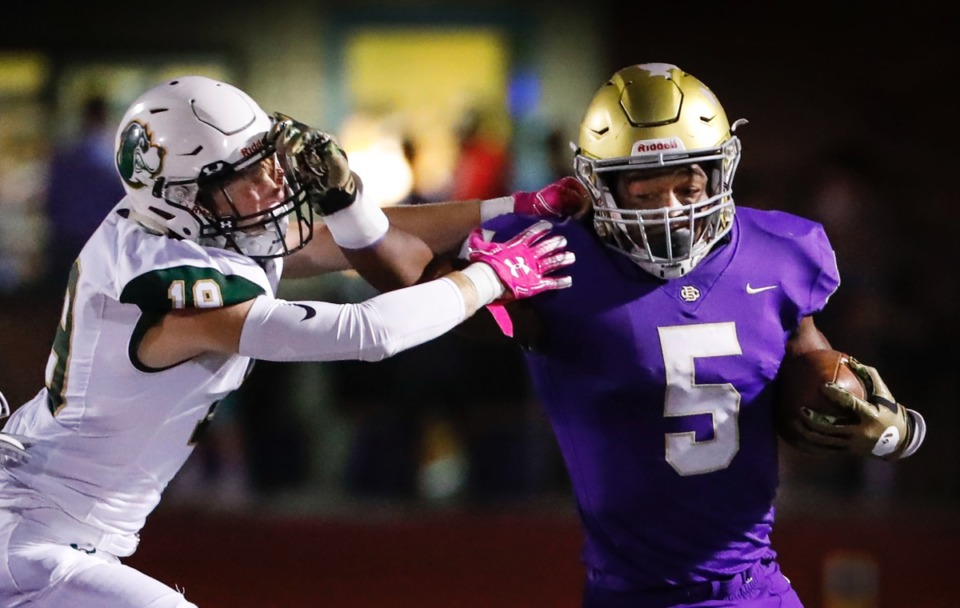 <strong>Briarcrest defender Alex Bellanti (left) brings down CBHS' Al Wooten on a kickoff return Friday, Oct. 4.</strong> (Mark Weber/Daily Memphian)