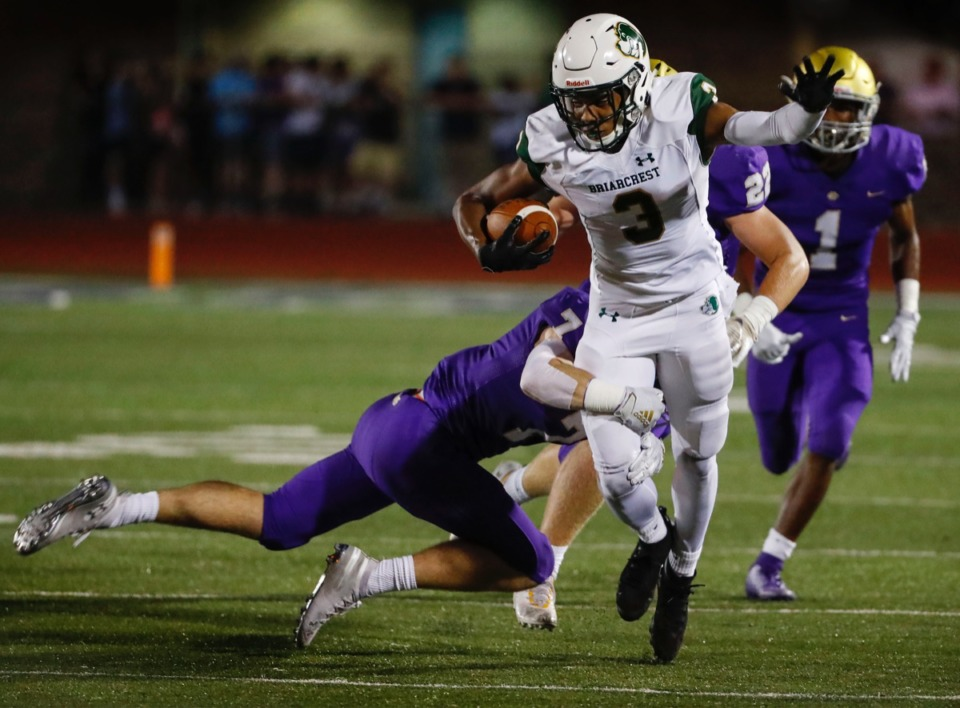 <strong>Briarcrest running back Reggie Neely (with ball) is tackled by CBHS defender Will Wallace Friday, Oct. 4.</strong> (Mark Weber/Daily Memphian)