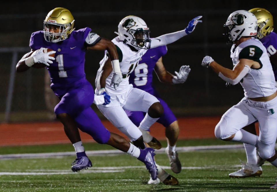<strong>CBHS running back Dallan Hayden (with ball) escapes Briarcrest defenders Friday, Oct. 4.</strong> (Mark Weber/Daily Memphian)
