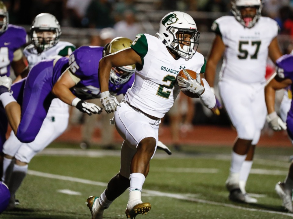 <strong>Briarcrest running back Jabari Small (with ball) scrambles past the CBHS defense Friday, Oct. 4.</strong> (Mark Weber/Daily Memphian)