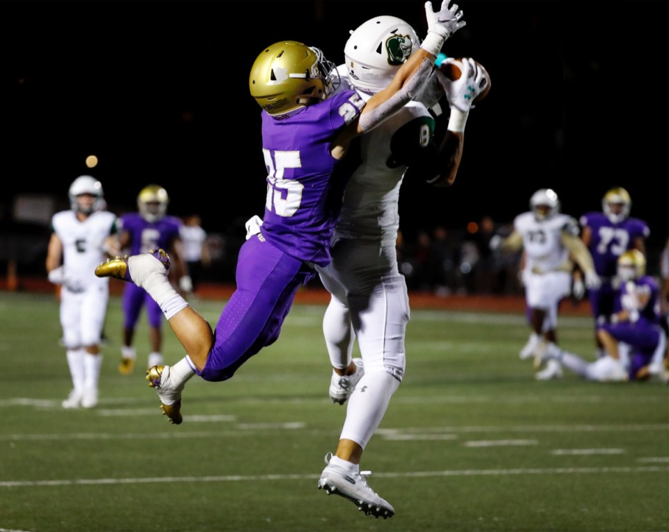 <strong>Briarcrest defender Jerrod Gentry (right) grabs an interception in front of CBHS receiver Michael Neuhoff (left) Friday, Oct. 4.</strong> (Mark Weber/Daily Memphian)