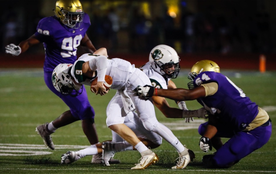 <strong>Briarcrest quarterback Michael Dallas (with ball) pulls out the grasp of CBHS defender Christian Dowell (right) Friday, Oct. 4.</strong> (Mark Weber/Daily Memphian)