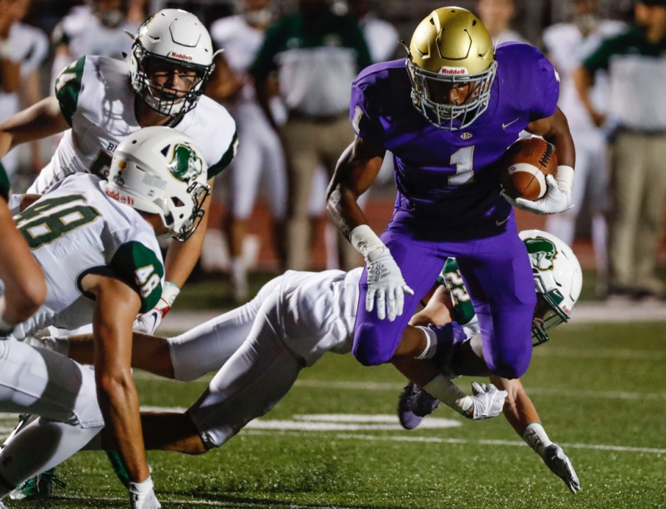 <strong>CBHS running back Dallan Hayden (with ball) is tackled by Briarcrest defender William Simonton (in back) Friday, Oct. 4.</strong> (Mark Weber/Daily Memphian)