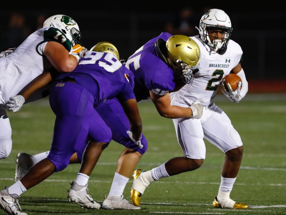 <strong>Briarcrest running back Jabari Small (with ball) is tackled by CBHS defender Connor Maness (center) Friday, Oct. 4.</strong> (Mark Weber/Daily Memphian)