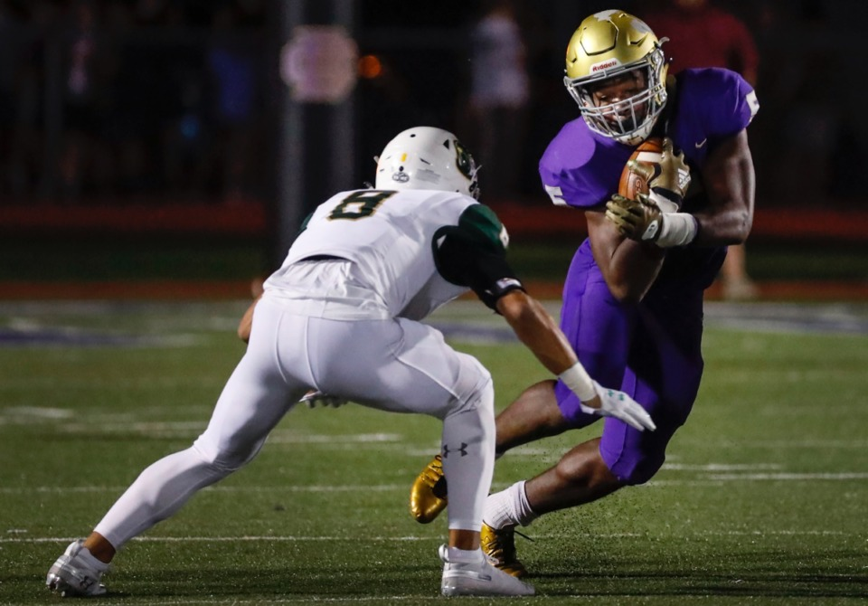 <strong>CBHS running back Al Wooten (with ball) scrambles past Briarcrest defender Jerrod Gentry Friday, Oct. 4.</strong> (Mark Weber/Daily Memphian)