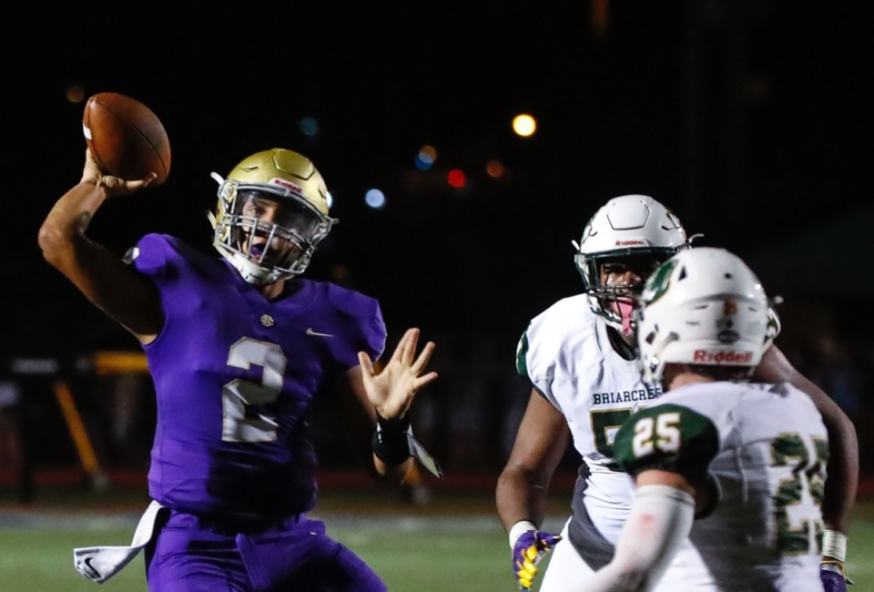 <strong>CBHS quarterback Ashton Strother (left) passes in the game against Briarcrest Friday, Oct. 4.</strong> (Mark Weber/Daily Memphian)