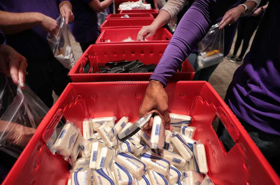 <strong>FedEx volunteers line up to build hygiene kits at the Memphis Botanic Garden on Friday, Oct. 26, 2018. </strong>(Jim Weber/Daily Memphian)