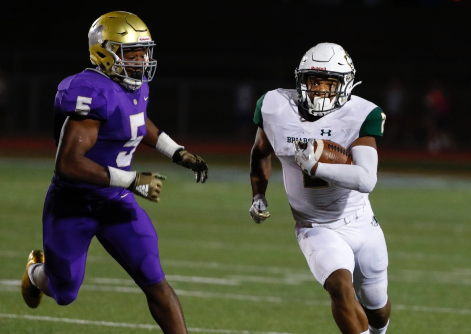 <strong>Briarcrest running back Jabari Small (right) runs by CBHS defender Al Wooten (left) on his way to a touchdown Friday, Oct. 4.</strong> (Mark Weber/Daily Memphian)
