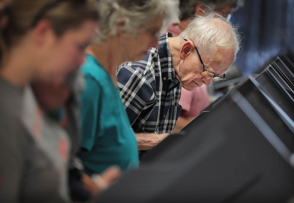 <strong>Hal Moore leans in close to getter a better look at the choices while casting his ballot at Mississippi Boulevard Christian Church on Oct. 3, 2019.</strong> (Jim Weber/Daily Memphian)