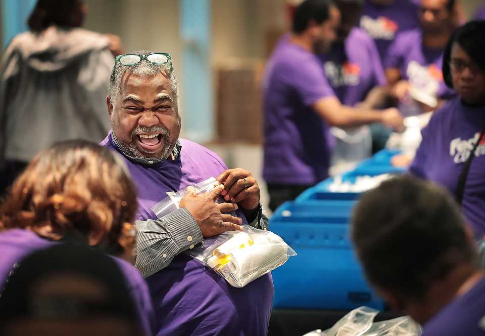 <strong>FedEx volunteer Ricky Anderson jokes with coworkers while sealing up hygiene kits at the Memphis Botanic Garden on Friday, Oct. 26, 2018. More than 100 volunteers turned out to build kits containing soap, toothpaste, towels and other basic necessities to be delivered to the Florida panhandle and other areas struck by recent natural disasters.</strong> (Jim Weber/Daily Memphian)