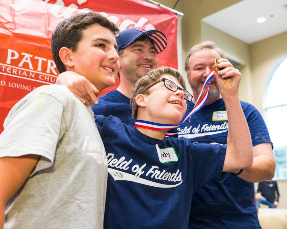 <strong>Andy Brister shows off his medal along with Jake Boyadjian (left), Coach David Peppel, and Coach Hal Perry Sunday at St. Patrick's Presbyterian Church in Collierville.</strong> (Ziggy Tucker/Special to The Daily Memphian)