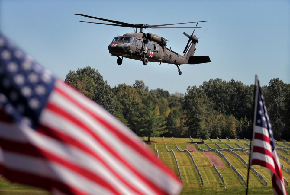<strong>A Black Hawk helicopter flies low over the West Tennessee State Veterans Cemetery during a memorial service for Major Trevor Joseph Oct. 8.</strong> (Jim Weber/Daily Memphian)