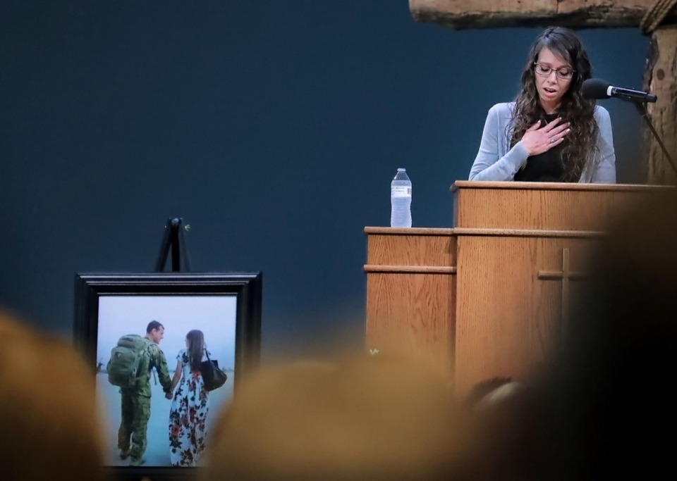 <strong>Erin Joseph, wife of Major Trevor Joseph, talks to a crowd of her husband's Army comrades, family and friends during the memorial service at Harvest Church on Oct. 8.</strong> (Jim Weber/Daily Memphian)