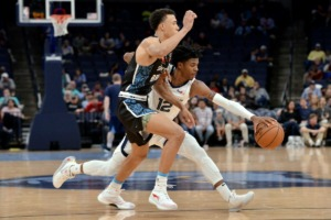 <strong>Memphis Grizzlies guard Ja Morant (12) goes full throttle gainst New Zealand Breakers guard R.J. Hampton at FedExForum Oct. 8.</strong> (Brandon Dill/AP)