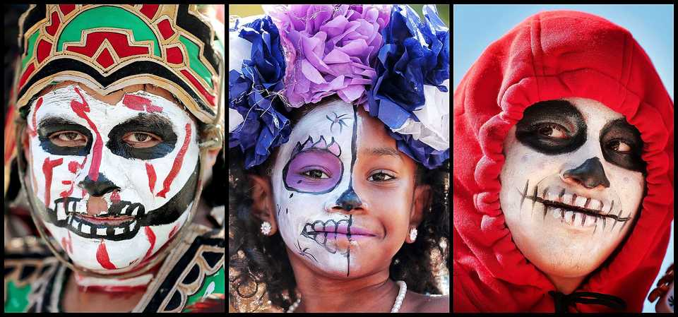 <strong>Jorge Mendoza (left), Antonia Abston, and Christian Montiel participate in the a Dia de los Muertos (Day of the Dead) parade from Overton Square to Overton Park on Oct. 27, 2018. The parade and fiesta are put on by the Brooks Museum of Art and Cazateatro Bilingual Theatre Group drawing from the Latin American tradition of honoring ancestors and celebrating the cycle of life and death.</strong> (Jim Weber/Daily Memphian)