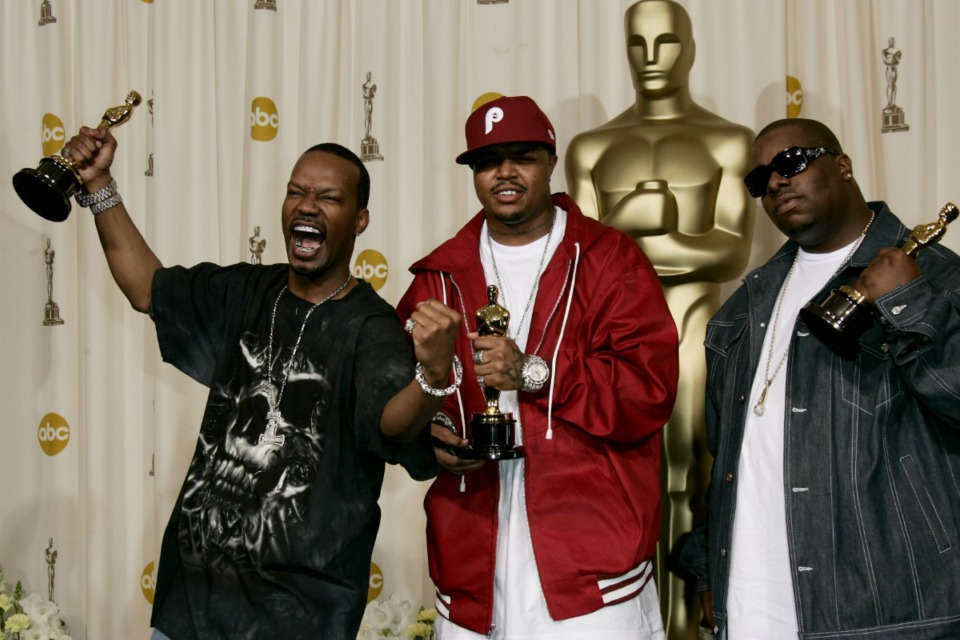 "<strong>Jordan ""Juicy J"" Houston (left) Paul ""D.J. Paul""Beauregard (center), members of the Memphis rap group Three 6 Mafia, and songwriter Cedric Coleman, pose with the Oscar for best original song for ""It's Hard Out Here for a Pimp"" from the motion picture ""Hustle &amp; Flow"" at the 2006 Academy Awards.</strong> (AP Photo/Kevork Djansezian)"