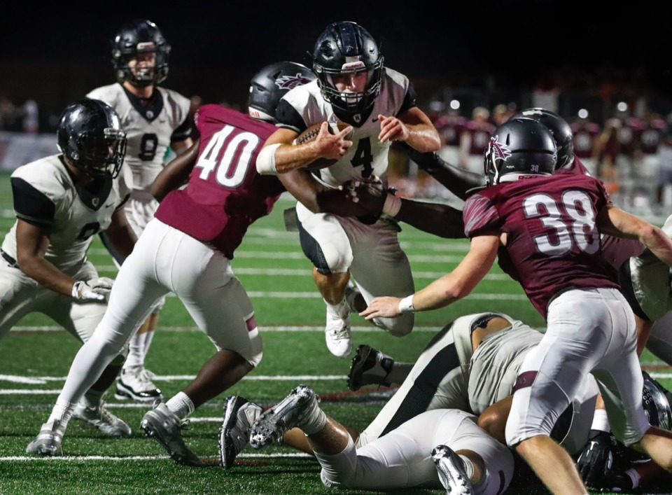 <strong>Houston running back Lincoln Pare (with ball) jumps over teammates before being tackled in the game against Collierville Oct. 10.</strong> (Mark Weber/Daily Memphian)