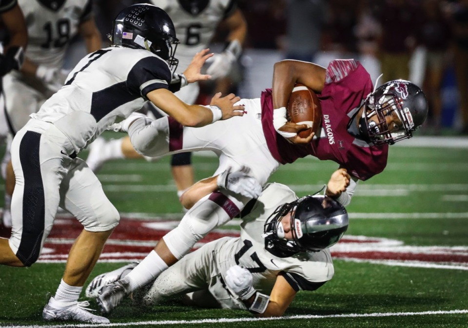 <strong>Collierville running back Jaden Spencer (with ball) runs for a first down before being tackled by Houston defenders Will Stegall (left) and Carson Goold (on ground) Oct. 10.</strong> (Mark Weber/Daily Memphian)