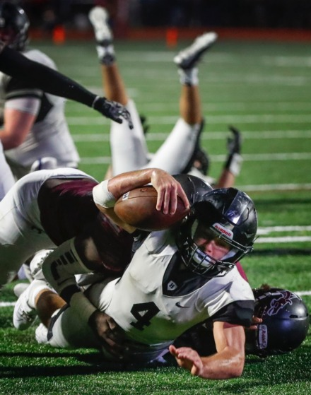 <strong>Houston running back Lincoln Pare (with ball) falls for positive yards against Collierville Oct. 10.</strong> (Mark Weber/Daily Memphian)