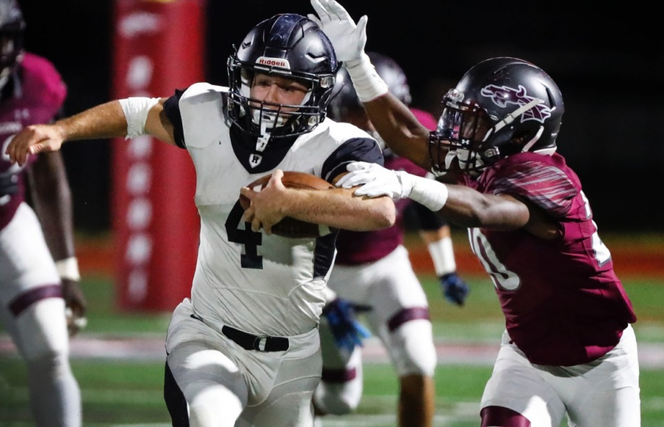 <strong>Houston running back Lincoln Pare (left) scrambles past Collierville defender John Hampton III Oct. 10.</strong> (Mark Weber/Daily Memphian)
