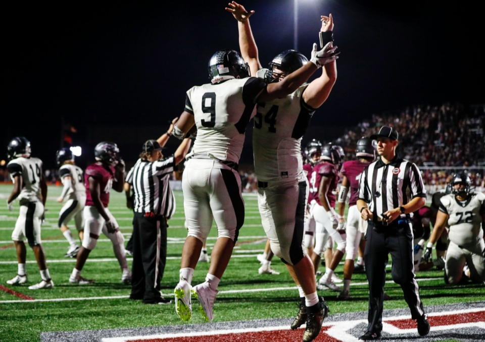 <strong>Houston's Deion Harris (9) celebrates his touchdown with teammate Nathan Havrda Oct. 10, in what appears to be an enthusiastic chest bump.</strong> (Mark Weber/Daily Memphian)