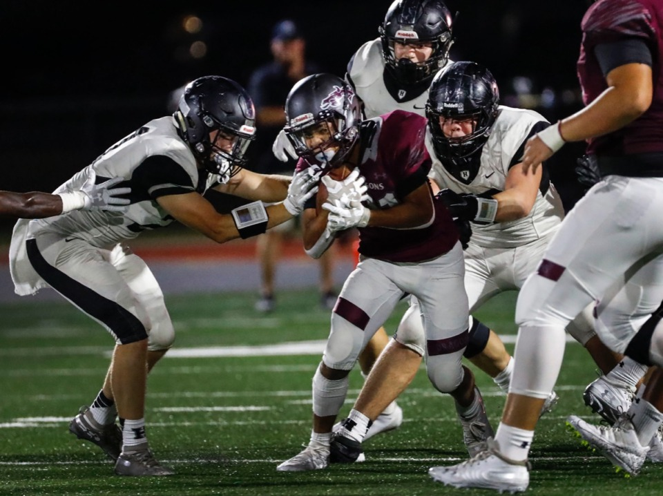 <strong>Collierville running back Duple Travillion (with ball) fights for positive yards aas he is swarmed by Houston defenders Oct. 10.</strong> (Mark Weber/Daily Memphian)
