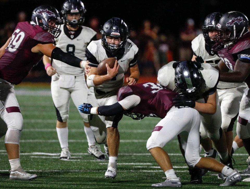 <strong>Houston running back Lincoln Pare (with ball) breaks though the Collierville defense Oct. 10.</strong> (Mark Weber/Daily Memphian)