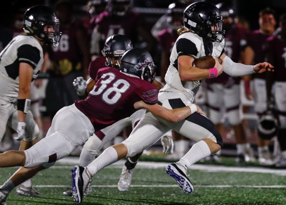 <strong>Houston quarterback Ethan Burns (with ball) gains a first down against the Collierville defense Oct. 10.</strong> (Mark Weber/Daily Memphian)