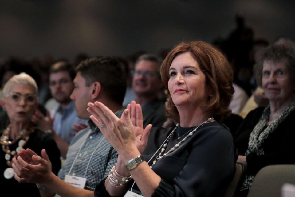 <strong>Lana Prosterman applauds during the seminar Oct. 10.</strong> (Patrick Lantrip/Daily Memphian)