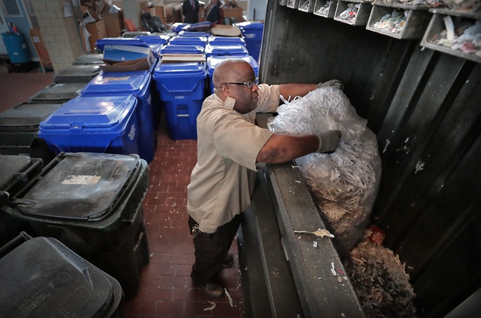 <strong>Recycling crew leader Jasper Netter dumps recycled paper into a bailing machine on Sept. 25, 2019, at the Shelby County Correctional Center, which has been recognized as a model for green prisons in Tennessee. Their initiatives include solar panels to heat water, new technology to dehydrate food waste, LED lighting throughout the facility and a recycling program for all the Shelby County offices.</strong> (Jim Weber/Daily Memphian)