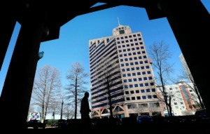 <strong>Raymond James &amp; Associates has plans to move from its Downtown office tower, the namesake and anchor for the 21-story building, to East Memphis.</strong> (Jim Weber/Daily Memphian file)