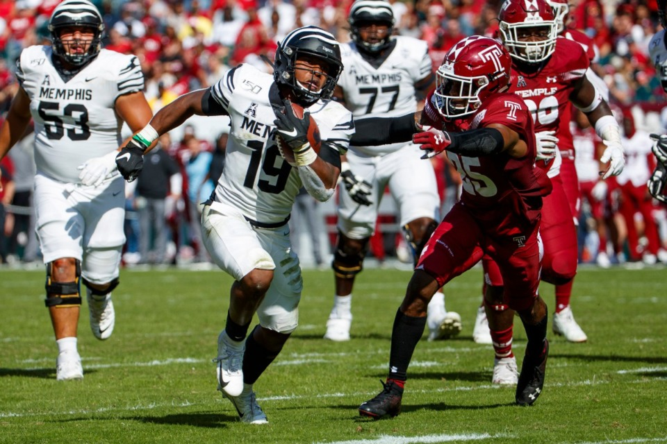 <strong>Memphis running back Kenneth Gainwell (19) runs for a touchdown as Temple safety Amir Tyler (25) reaches for him during a game Saturday, Oct. 12, 2019, in Philadelphia.</strong> (AP Photo/Chris Szagola)