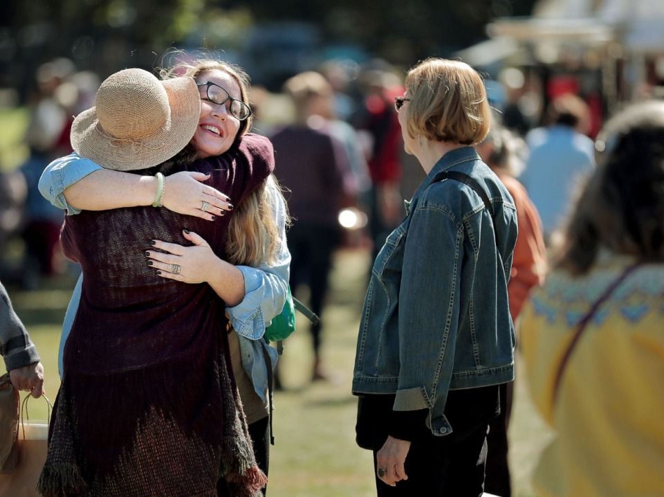 <strong>Beth O'Neil (left) and Laura Boyd meet up at the 47th annual Pink Palace Crafts Fair on Oct. 12, 2019 at Audubon Park, where some 200 craftsman peddle a range of handmade goods including pottery, textiles, glass, jewelry and fine art to raise money for the Pink Palace family of museums.</strong> (Jim Weber/Daily Memphian)