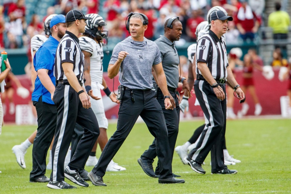 <strong>Memphis head coach Mike Norvell has words with the officials after a play was overturned by replay during the second half of an NCAA college football against Temple, Saturday, Oct. 12, 2019, in Philadelphia. Temple won 30-28.</strong> (AP Photo/Chris Szagola)