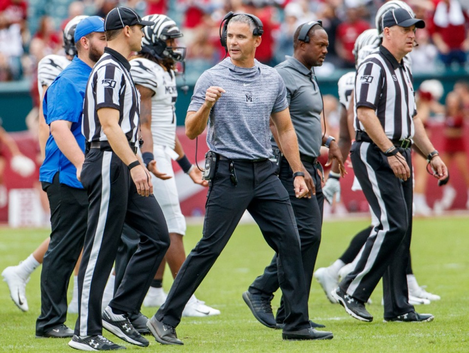 <strong>Memphis head coach Mike Norvell has words with the officials after a play was overturned by replay during the second half of an NCAA college football game against Temple, Saturday, Oct. 12, 2019, in Philadelphia. Temple won 30-28.</strong> (AP Photo/Chris Szagola)