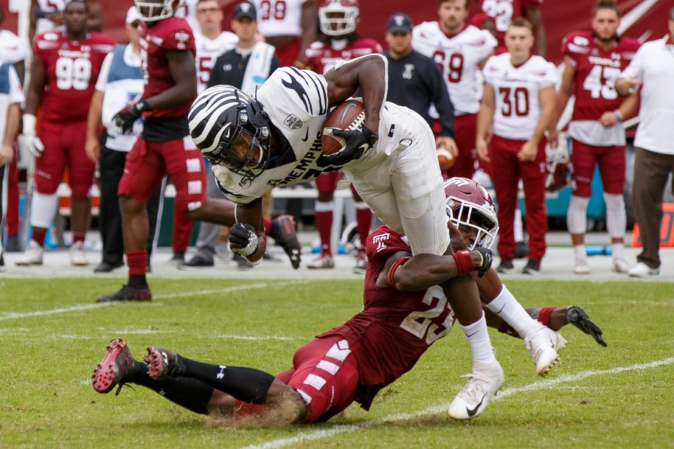<strong>Memphis wide receiver Damonte Coxie (10) gets tackled by Temple cornerback Harrison Hand (23) to end the second half of an NCAA college football game on Saturday, Oct. 12, 2019, in Philadelphia. Temple won 30-28.</strong> (AP Photo/Chris Szagola)