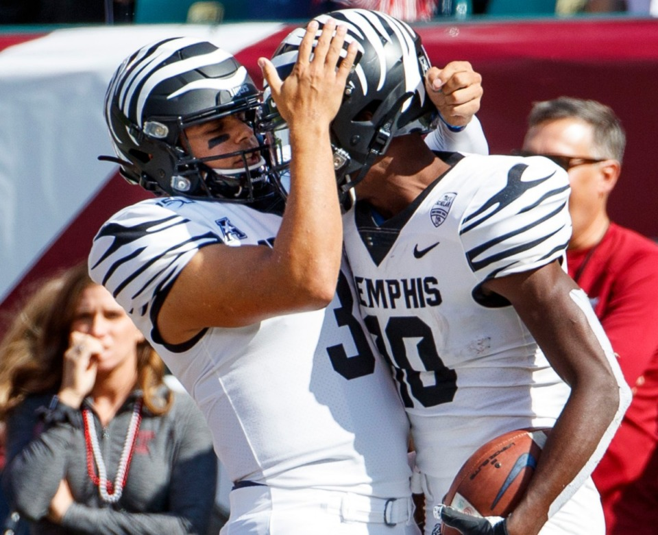 <strong>Memphis wide receiver Damonte Coxie (10) celebrates his touchdown with quarterback Brady White (3) during an NCAA college football game against Temple on Saturday, Oct. 12, 2019, in Philadelphia.</strong> (AP Photo/Chris Szagola)