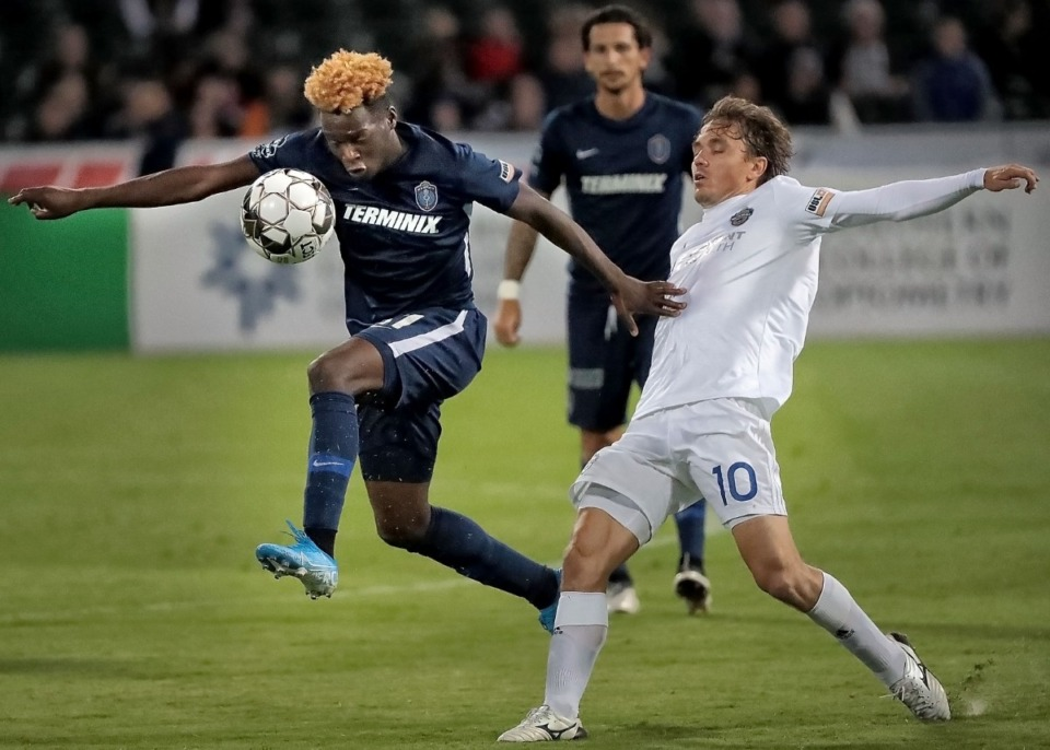 <strong>Memphis forward Lagos Kunga steals the ball from Charlotte's Jorge Herrera during 901FC's 1-2 loss to the Charlotte Independence SC at AutoZone Park on Oct. 12, 2019.</strong> (Jim Weber/Daily Memphian)