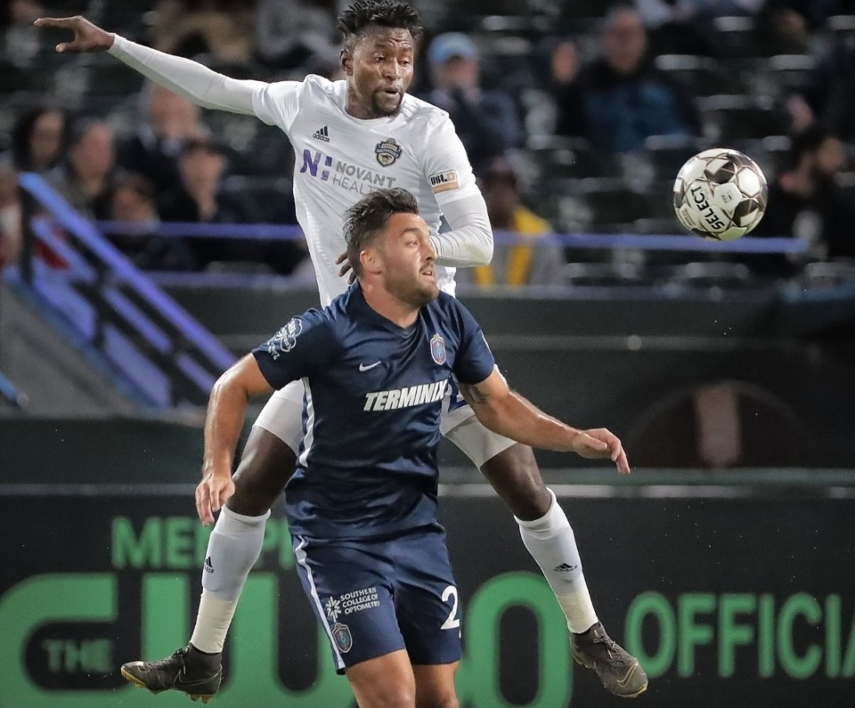 <strong>Memphis forward Brandon Allen (29) looses the first touch to Charlotte's Abdoulie Mansally during 901FC's 1-2 loss to the Charlotte Independence SC at AutoZone Park on Oct. 12, 2019.</strong> (Jim Weber/Daily Memphian)