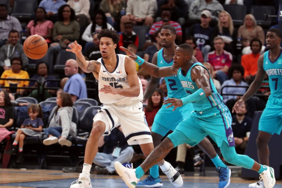 <strong>The Grizzlies' Brandon Clarke (15) passes the ball as Charlotte's Terry Rozier lll (3) closes in during the first half of a preseason NBA basketball game Oct. 14 at FedExForum.</strong> (Karen Pulfer Focht/AP)