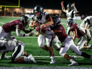 <strong>Houston running back Lincoln Pare (with ball) scores a touchdown despite the best efforts of the Collierville defense Oct. 10.</strong> (Mark Weber/Daily Memphian)